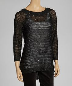 Get ready to shimmer and sizzle. This super-sparkly sweater will not only turn heads, it'll shoot any fashionable woman to the top of the style list.