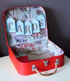 great idea for collecting cards at a wedding - @Samantha Gagen do you like this? I have my grandmother's old suitcase that we could paint and use if you do.