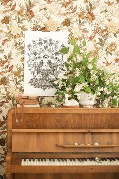 brown floral print wallpaper + piano