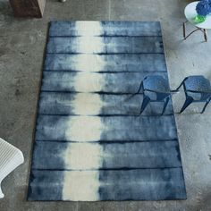 Savine Indigo Rug A spectacular hand woven pure wool rug, authentically tie dyed making each unique and distinctive. The natural ombres shad...