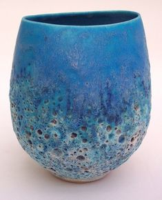 David Brown ceramics--gorgeous blue palette (teeny tiny hint of brown'ish orange in the little craters make it interesting)