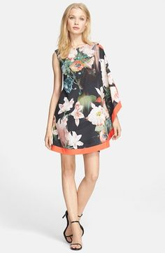 Free shipping and returns on Ted Baker London 'Opulent Bloom' Print Tunic Front Dress at Nordstrom.com. Grand-scale flowers grace the diaphanous tunic overlay that transforms a ponte-knit sheath into a work of wearable art.
