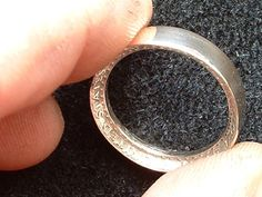 How to Make a Ring Out of a Quarter @ http://snapguide.com/guides/make-a-ring-out-of-a-quarter/ Also video @ http://www.youtube.com/watch?v=yOWkwUqzqPk & Half Dollar Ring Video @ http://www.youtube.com/watch?annotation_id=annotation_503503&feature=iv&src_vid=yOWkwUqzqPk&v=bQnQniNVxzI
