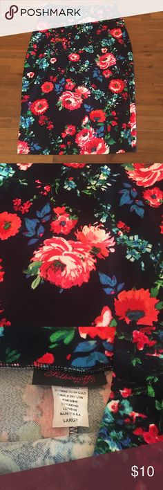 Beautiful high waist floral pencil skirt Like new size large skirt. Navy blue with bright reddish pink flowers. Also has green blue and purple in the print. 96% polyester and 4% spandex. Length is 25 1/2 inches. Waist 28 1/2 inches. Smoke free home. No stains or tears. silhouette NYC Skirts Pencil