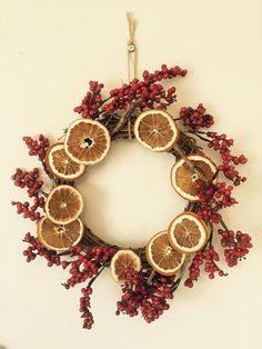 Stunning Christmas wreath, made using traditional, Victorian style decorations including hand dried orange slices. A unique item, to add a traditional feel to your Christmas decor. This wreath is based on a woven frame and has a string for hanging on your door at Christmas. Please note, the orange slices are made from real fruit, which has been dried in house, but the berries are not from real fruit. #christmas #wreath #victorian #traditional #dickensian #orange