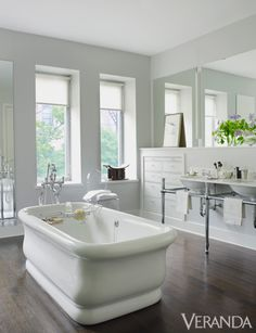A gray and white palette creates a calm master bathroom.