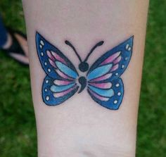 A beautiful butterfly semicolon tat. The semicolon serves as the body of the tattoo. Which could mean that before you can have a real new beginning, you have to live your life.