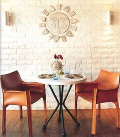 Carve out a little niche for yourself that makes you smile, despite the size. Little details like the sun plaque on the wall, sun vase, and even little bird salt and pepper shakers create a cheery and comfortable dining area, visit homecraftsdiy.com for more