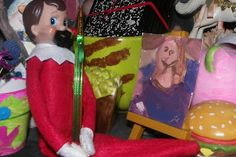 Day 10 Charlie elf on shelf dressed as Bob Ross and painted us a tiny Mona Lisa
