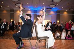 """""""The Shoe Game"""" is a fun way to pass the time between dinner and dancing. Here's how it works: Place two chairs back-to-back on the dance floor, and trade a shoe with your new spouse so that you're both holding one of each. The maid of honor or best man will ask a series of questions about your relationship (e.g. """"Who said I love you first?""""). You and your husband have to hold up the shoe of the person you think is the best answer to each question."""