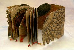 'Sunflower' book made from brown paper with illustration and stitch (click to enlarge)
