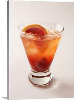 A tequila old-fashioned with blood red orange