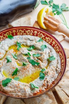 Baba Ghanoush - is a levantine dish made with grilled eggplant, tahini, lemon juice, garlic and salt which are basically the same ingredients in hummus replacing the chickpeas with roasted eggplant and that makes it a great, lighter alternative to hummus. Think Food, Love Food, Vegetarian Recipes, Cooking Recipes, Healthy Recipes, Lebanese Recipes, Eggplant Recipes, Middle Eastern Recipes, Mediterranean Recipes