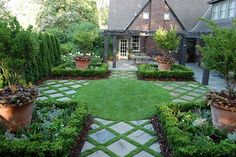 Large concrete patio stones with grass in-fill for an ornate patterned look.