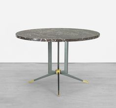 Jules Leleu - occasional table - France, c. 1950 marble, enameled steel, brass 29.5 dia x 19.75 h inches