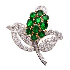 Cartier Emerald Diamond Gold Platinum Floral Brooch . Circa 1960s