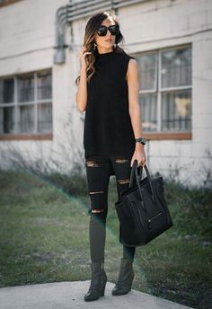 Black Sleeveless sweater styled with jeans. Similar style available on SiiZU.com