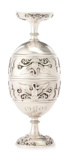 Fabergé silver egg-form traveling vodka cups, Moscow, 1898-1905, of egg form with spreading feet that can be removed and stored inside the cups, the body decorated with swans and anthemia amongst scrolling ornament, engraved with the commemorative date 17 April 1905. By tradition, traveling toasting cups of this sort were given to survivors of the Battle of Tsushima.