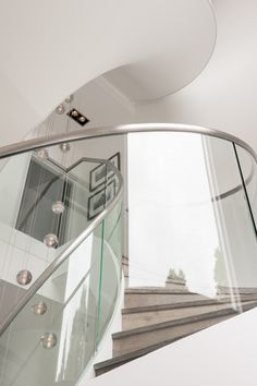 Double flight helical staircase in a London home. #staircase #helical #glass #mildsteel #stair #London #design