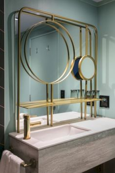 The bathrooms feature bronze accents. Luxury Master Bathrooms, Bathroom Design Luxury, Bathroom Design Small, Bathroom Interior, Modern Bathroom, Luxurious Bathrooms, Bathroom Designs, Bathroom Ideas, Bathroom Showrooms
