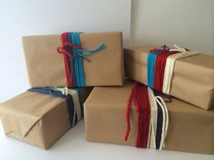 Behind the scenes at Seasalt's window design studio.  Brown paper parcels for knitted Christmas 2014.