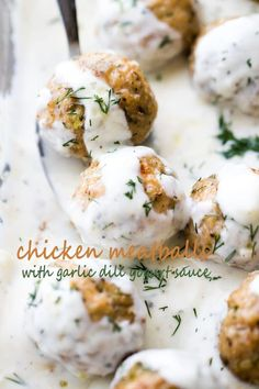 Baked Chicken Meatballs with Garlic Dill Yogurt Sauce - Tender, juicy, perfectly seasoned baked chicken meatballs topped with a delicious garlic and dill yogurt sauce.