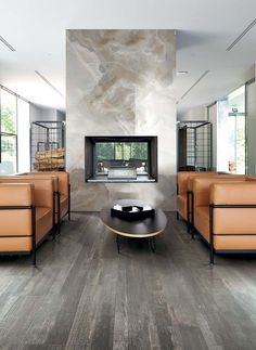 The brilliant details of I Classici di Rex suggest a well-balanced luxury between the traditional and the modern. #woodtiles #porcelain #flooringideas #brownfloor #magnumoversize #luxury #interiordesign