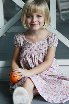 Flowered cap sleeved smocked dress.   #orientexpressed #summer #kidsclothing
