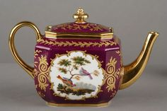 "Paris Porcelain Tea set, Paris Porcelain Tea set decorated with different birds in a landscape. The set is enriched with gold foliage on a red background. Label ""Maison Marceaux, Place de la Bourse de Paris. Includes six cups and plates, a teapot, a milk pot and a sugar pot.Circa"