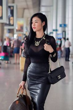 Lovely combination of leather skirt and sheer top.