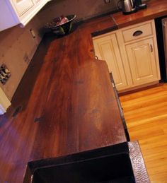 Love the look of wood counters, but need someting more durable? WoodForm Concrete Countertop - Cast on a wood plank mold and stained to look like wood