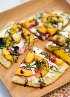 Summer Peach and Balsamic Pizza: 1 batch organic pizza dough / (use your favorite recipe) 1 cup balsamic vinegar 2 tablespoons olive oil 8 ounces fresh mozzarella, sliced or grated 2 ounces soft goat cheese, crumbled 4 peaches, pitted and thinly sliced 1/2 cup coarsely chopped basil