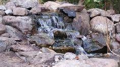 Waterfall created by Poseidon Ponds & Landscaping in Dexter, MI. WaterfallWednesday