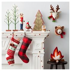 Bring warm crisp color to your holiday display with the Camp Christmas Decor Collection. In this cheerful collection you'll find rich red flannel stockings, fuzzy woodland creatures wearing scarves and modern Christmas trees with twinkling lights for your mantle.