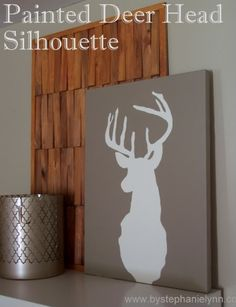 For Karl Under The Table and Dreaming: DIY Deer Head Silhouette Wall Art Decor How to repurpose an old canvas - MyHomeLookBook