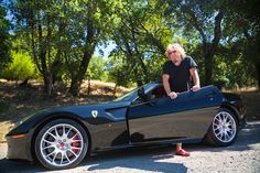 Sammy Hagar steps out of his Ferrari.