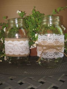 Burlap Lace Centerpiece Effortless white flowers like hydrangea and baby's breath can be arranged in a mason jar wrapped in twice and lace for a simple and inexpensive centerpiece.