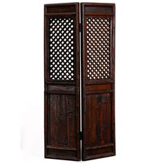 The panels in this screen were once used as dividers inside a home in Shanxi province but have been fitted together with brass hinges to form a simple screen. Made from elm wood, they have been refinished in a dark brown lacquer, showing the attractive wood grain. The lattice section in the upper part of each panel is bevelled, set within chunky rounded frames.