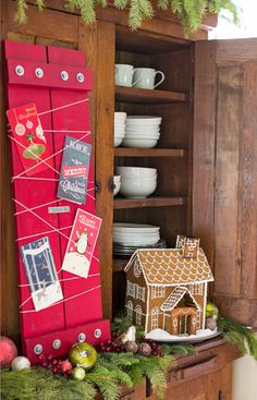 Display Christmas cards in a rustic fashion with a festive holder made from boards, hardware, and string.