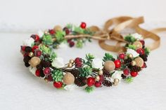 Wedding winter crown succulent cones red berries white roses
