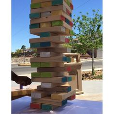 A game of Giant Jenga at our CGroup Family Picnic last weekend! Shawn and Kyle's Branden doing the honors.  #giantjenga #bbq #family #cgroup #remax #realestate #vegas #lasvegas #realestatelife