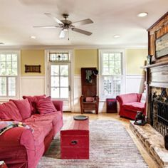 love the distressed fireplace and comfy red couches
