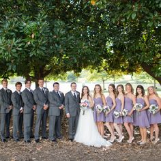 groomsmen sported gray vera wang suits from men's warehouse, which they accessorized with classic black ties | TheKnot.com