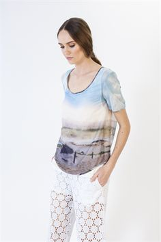 A contemporary take on the classic t-shirt showcases the intriguing print of a photo-realistic landscape. The top has a knit layer underneath, a rounded hemline and an open back. Just add shorts and great sunglasses. Size & Fit: Model is 177cm tall Model wears a NZ 8/ EU 36/ US 6 Wash Guide: Cool hand wash only. Wash inside out. Do not bleach. Wring. Rub. Soak or tumble dry. Lay flat to dry in shade. Cool iron on reverse. Drycleanable. Fabric Composition: Main: 100% Cotton Lining: 95% Visco…