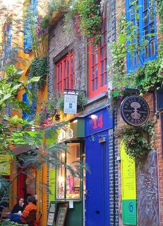 Colourful stores including the original Neal's Yard store named after it's location -  Neal's Yard, Covent Garden, London WC2.