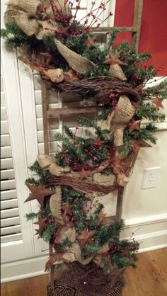Ladder with pine garland, burlap ribbon, red pip berry, rusty stars, angel hair garland and burlap feathered birds Christmas Swags, Burlap Christmas, Primitive Christmas, Outdoor Christmas Decorations, Country Christmas, Christmas Home, Holiday Decor, Burlap Ribbon, Burlap Garland