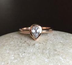 Pear Shape White Sapphire Promise Ring- 14k Rose Gold Engagement Ring- White Gemstone Bridal Wedding Ring- September Birthstone Ring by Belesas on Etsy https://www.etsy.com/listing/386537664/pear-shape-white-sapphire-promise-ring