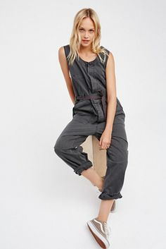 fc0f69f4a2 In a lightweight cotton this one-piece jumpsuit features button closures  down the front. Four-pocket style with a single front bust pocket.