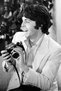 Paul McCartney with a camera