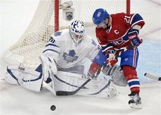 Kadri, Bozak lead Maple Leafs past Canadiens 2-1 - Yahoo! Sports Photos.  Toronto Maple Leafs' goaltender Ben Scrivens makes a save against Montreal Canadiens' Brian Gionta (21) during the first period of an NHL hockey game in Montreal, Saturday, Jan. 19, 2013. (AP Photo/The Canadian Press, Graham Hughes)
